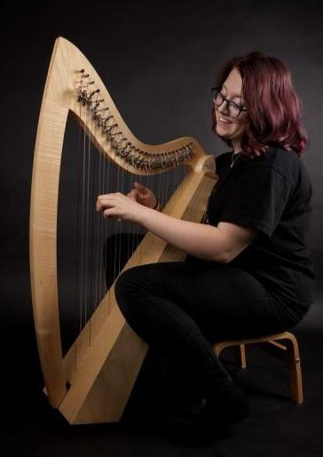 Ellie playing deluxe harp